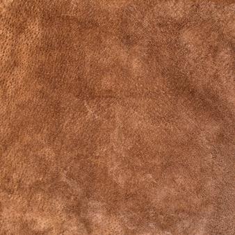 Gamuza suave textura fluida. color marrón. piel genuina