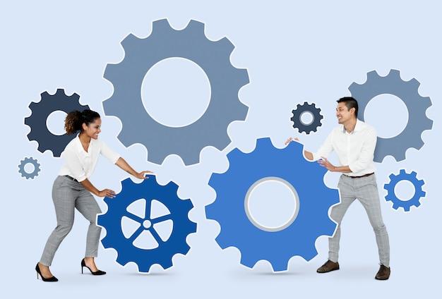 Gente de negocios conectando con engranajes