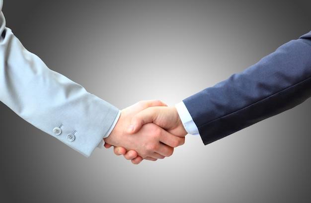 Gente de negocios dándose la mano, terminando una reunión Foto Premium