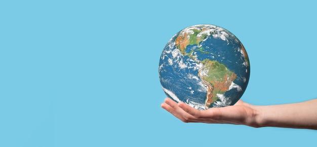 Globo del planeta tierra 3d en el hombre