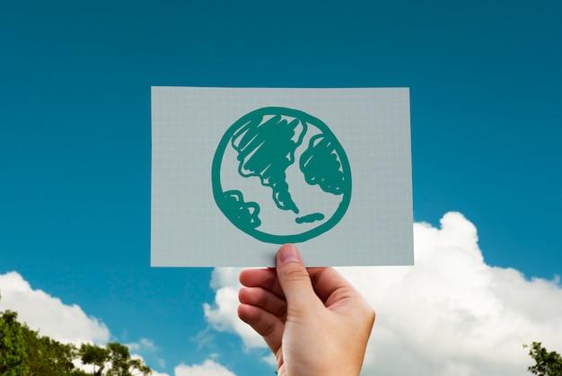 Globo verde dibujado en una tarjeta