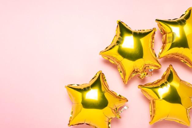 Globos aerostáticos en forma de lámina de oro en rosa
