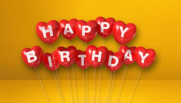 Globos de aire de forma de corazón rojo feliz cumpleaños en una escena de fondo amarillo. banner horizontal. render de ilustración 3d