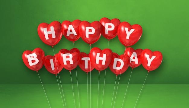 Globos de aire de forma de corazón rojo feliz cumpleaños en una escena de fondo verde. banner horizontal. render de ilustración 3d