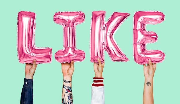 Globos de helio de alfabeto rosa formando el texto como