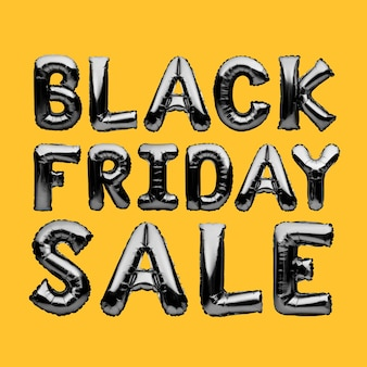 Globos de helio negro que forman las palabras venta de viernes negro sobre fondo amarillo.