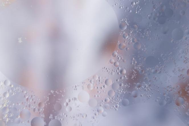 Gotas de agua sobre el fondo con textura