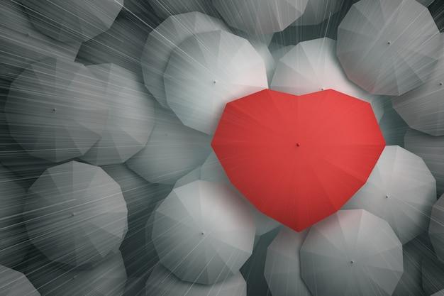 Gotas de lluvia cayendo desde lo alto del cielo sobre el paraguas en forma de corazón