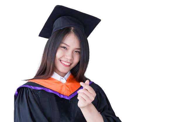 Graduación linda asiática del retrato de las mujeres aislada en el blanco, universidad de tailandia