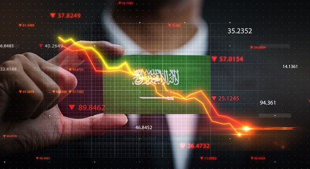 Gráfico cayendo frente a la bandera de arabia saudita. concepto de crisis
