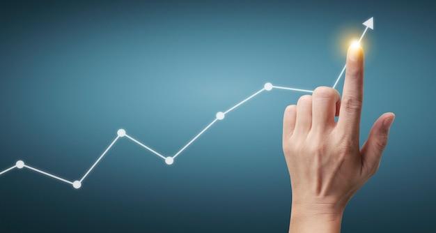 Gráficos conmovedores de la mano del indicador financiero y el gráfico de análisis de economía de mercado contable