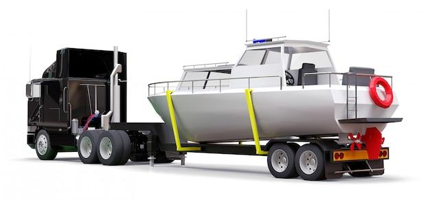 Un gran camión negro con un remolque para transportar un barco sobre un fondo blanco.