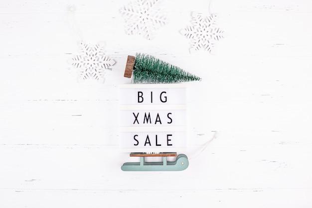 Gran venta de navidad caja de luz de texto superficie blanca