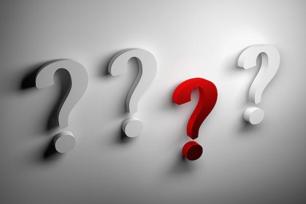Grandes signos de interrogación blancos y uno rojo