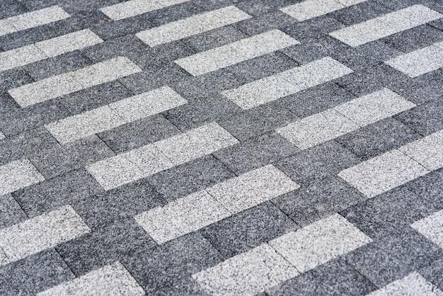 Granito de fondo con textura rectangular. azulejos de suelo gris claro y gris oscuro.