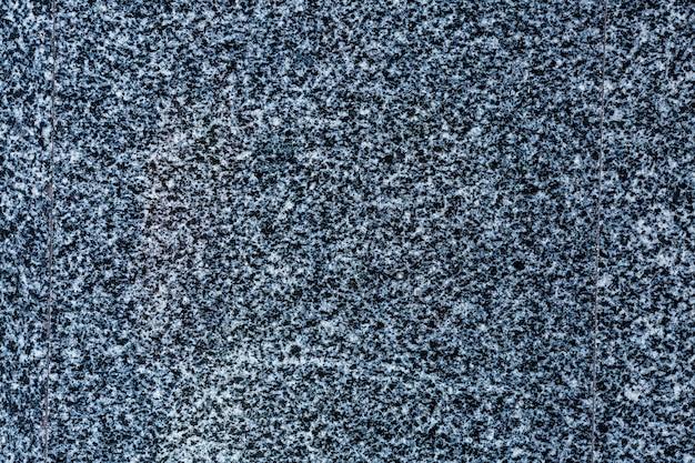 Granito pulido. fondo de textura y superficie de piedra de granito gris natural real.