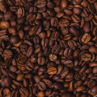 Granos de café con textura de fondo