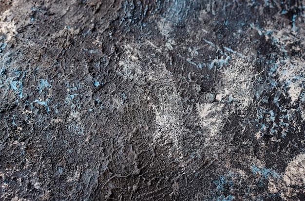 Gris oscuro con textura de muro de hormigón azul