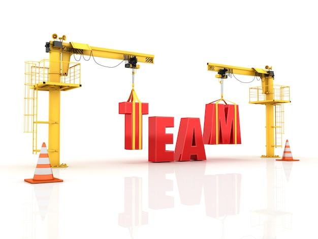 Grúas construyendo la palabra equipo