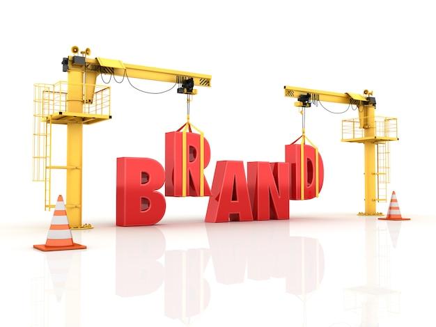 Grúas construyendo la palabra marca