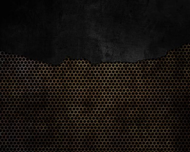 Grunge agrietado sobre un fondo de metal perforado
