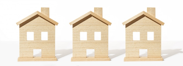 Grupo de casa de madera modelo sobre fondo blanco.