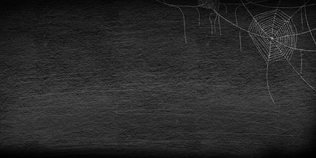 Grupo de dibujo de telaraña en la esquina sobre fondo vintage retro pizarra para fiesta de noche de halloween