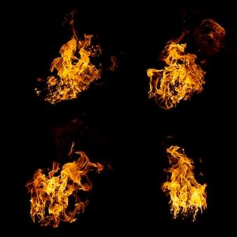 Grupo de llamas reales y calientes están ardiendo sobre un fondo negro
