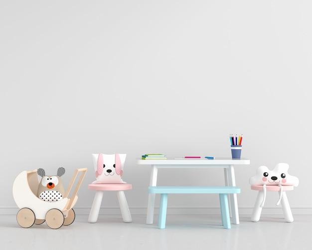 Habitación blanca para niños con sillas y mesa.