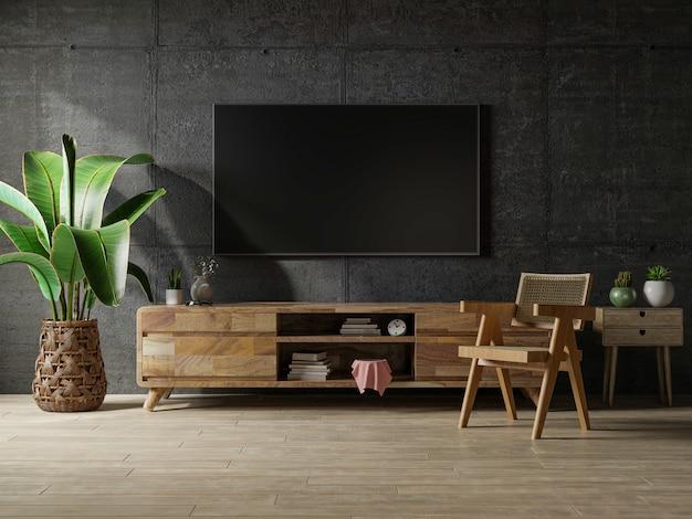 Habitación vacía del espacio del desván con la televisión y el gabinete en la representación oscura del fondo interior de hormigón.