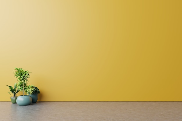 Habitación vacía con plantas maqueta tiene piso de madera en la pared amarilla de fondo