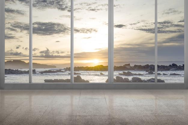 Habitación vacía con vista al mar y rocas