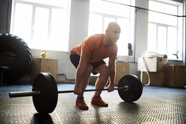 Hacer ejercicio con barra