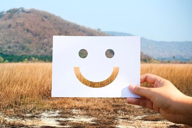 Happines alegre cara de papel perforado alegre