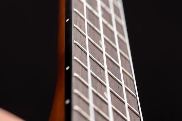 Hecho de guitarra pequeña de caoba para tocar música, partes de guitarra de caoba profesional.