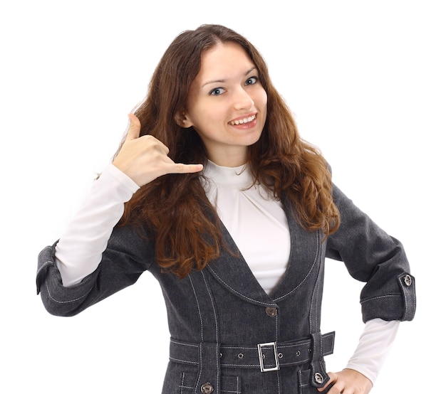 La hermosa mujer de negocios en el teléfono sobre un fondo blanco.