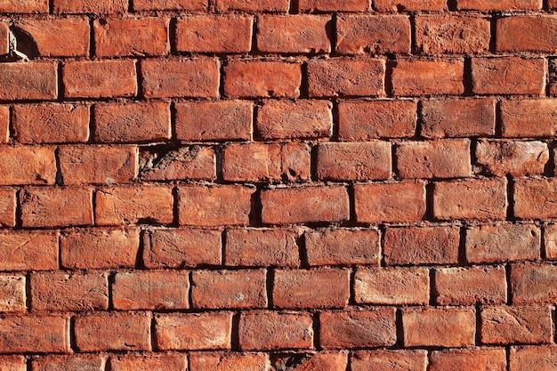 Hermosa pared de ladrillo rojo para superficie o textura