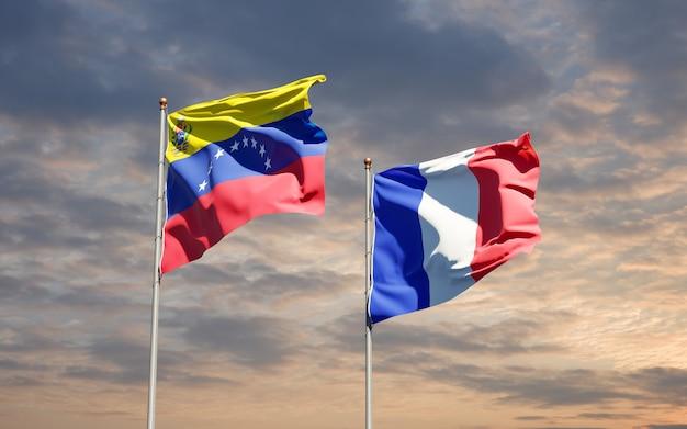 Hermosas banderas del estado nacional de francia y venezuela juntos en el cielo