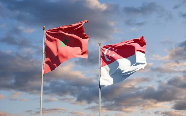 Hermosas banderas del estado nacional de marruecos y singapur juntos