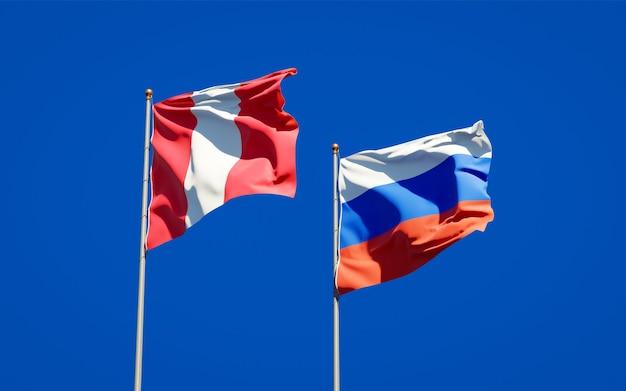 Hermosas banderas del estado nacional de perú y rusia juntos en el cielo azul. ilustraciones 3d