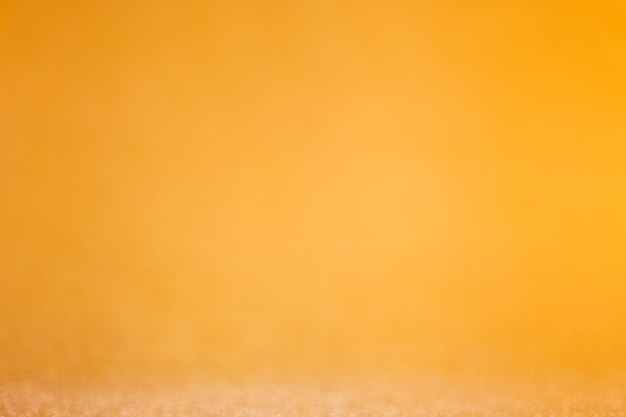 Hermoso fondo dorado brillo desenfocado con espacio de copia