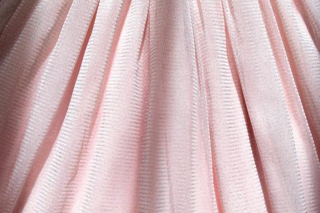 Hermoso fondo rosa delicado. texto de primer plano de tela esponjosa malla brillante