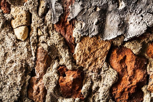 Hermoso grunge antiguo irregular textura de ladrillo de hormigón de la pared áspera. color gris. fondo contexto. horizontal.