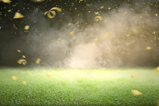 Hierba verde con humo y confeti dorado volador