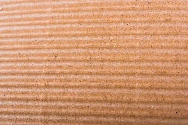 Hoja de cartón corrugado marrón de textura de papel o fondo