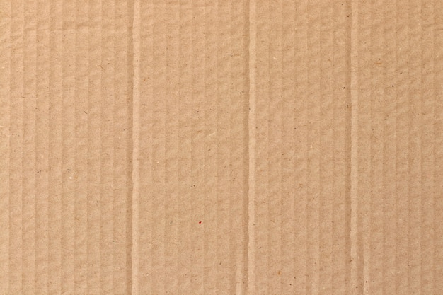 Hoja de cartón marrón, textura de caja de papel reciclado.