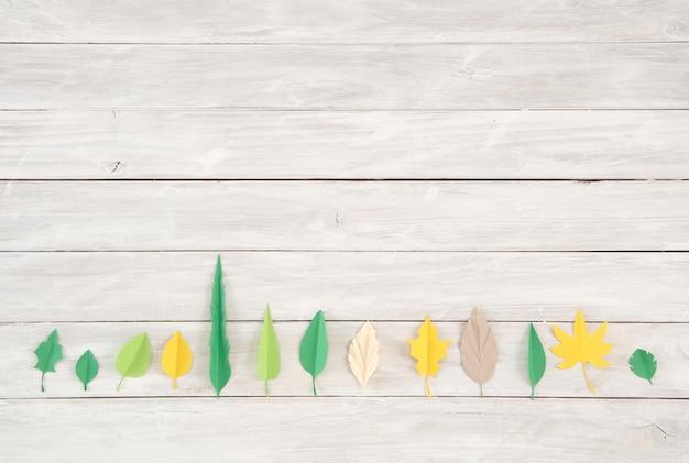 Las hojas están hechas de papel de colores. corte de papel de estilo artesanal de moda. diseño moderno para adve