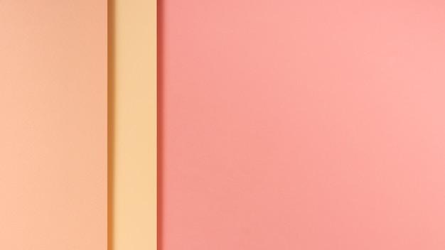 Hojas de papel de tonos rosa con espacio de copia