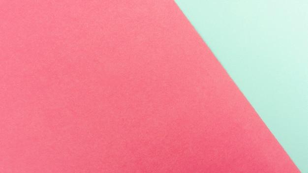 Hojas de papel verde menta y rosa