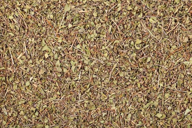 Hojas de tomillo secas closeup vista superior de hierbas medicinales té verde fondo de alimentos naturales